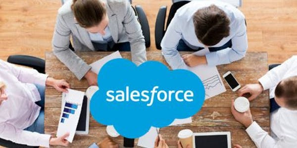 A group of four profressionals discussing about Salesforce Training Course